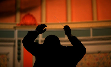 A-conductor-directs-his-m-006