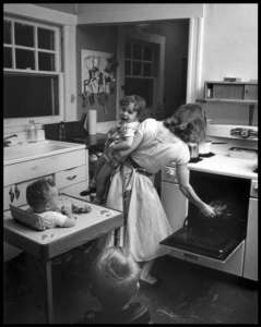 Elliott Erwitt New Rochell, NY, 1955 (busy mom)